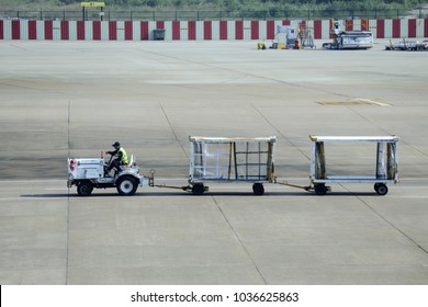 MACAO, CHINA - OCT 22: airport baggage trailer at the macau international airport on Oct 22 2017.