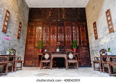 Macao/Macau - April 2, 2016 : Traditional oriental chinese heritage building, wood table, chair and decorate with beautiful orchid in Macao/Macau, China