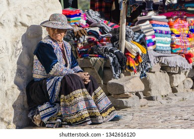 Maca/Peru - 09/03/2018: Peruvian woman selling craftwork to tourists in the streets of Maca