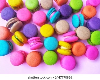 Macaron has a variety of flavors placed on a pink background, delicious macaroon dessert