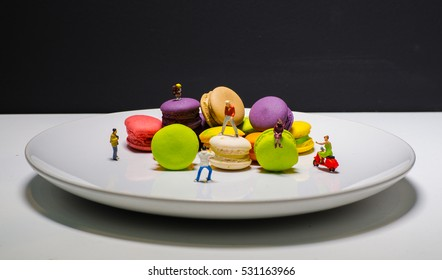 Macaron or Macaroon is sweet meringue-based confection and Miniature.