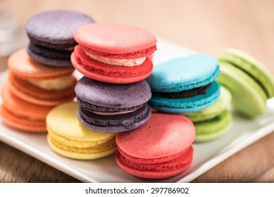 Macaron in plate on wood table