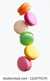 Macaron Sweets. Colorful Macaroons Flying