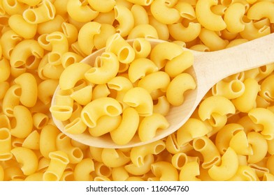 Macaroni background with wooden spoon