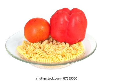 Macaroni with bell pepper and tomato in a transparent plate isolated on white background