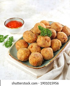 Macaroni Brulee Bomb, a contemporary savory snack in Indonesia, similar to Bitterballen, the ingredients are macaroni, smoked beef, milk, flour, cheese, filled with mozzarella. Breaded and deep fried.