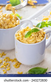 Macaroni and cheese homemade served in mugs