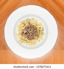 Macaroni with extra virgin olive oil, minced meat, onion and natural oregano