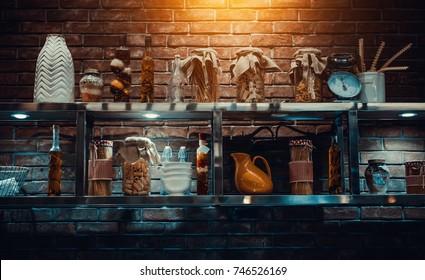 macaroni jars and oil bottles on the shelf in retro kitchen