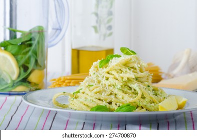 Macaroni with pesto, pesto with olive oil, herbs, nuts and Parmesan, sprinkled with fresh basil and parmesan