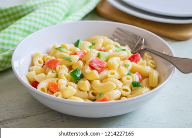 Macaroni salad with elbow pasta and vegetables in bowl