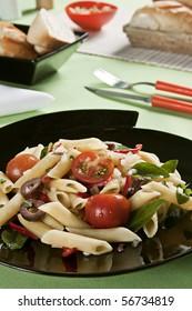 Macaroni salad. Food photography. Italian cuisine accompanied with salad.