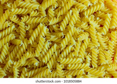 Macaroni. A seamless food texture. Use this texture in fabric and material prints, image backgrounds, posters and menus, invitations, collage, gift wrap, wallpaper, within type designs etc.