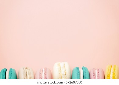 Macarons cake, top view flat lay, handmade pattern on pink background. Concepts about decoration, food background