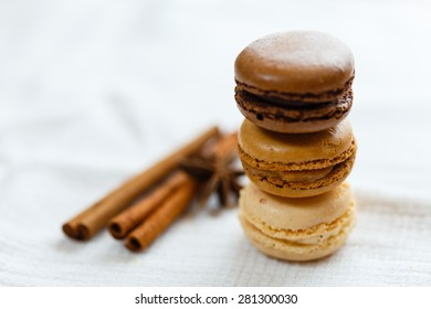 Macarons with cinnamon  sticks and anise seeds