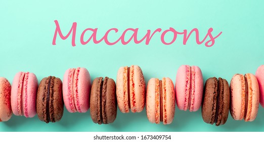 Macarons concept. Letters macarons on turquose bright bacground and row of french macarons