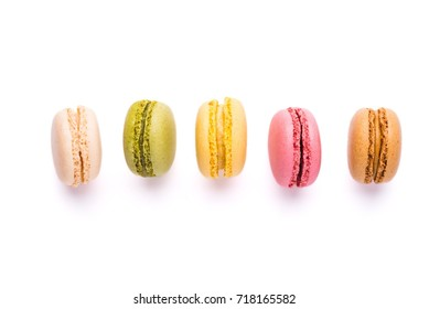 Macarons isolated over white background, top view