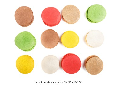 Macarons on a white background. Many colored macaroons top view.