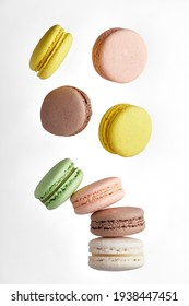 Macaroon. Colorful cake macaron with pastel tones fall at the stack macaroon on white background. Top view of almond cookies