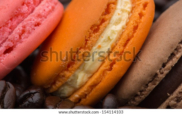 macaroon cookies on a background of coffee beans