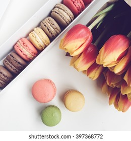 Macaroon and tulips on white background. Spring greeting card. iPhone 6s shooting