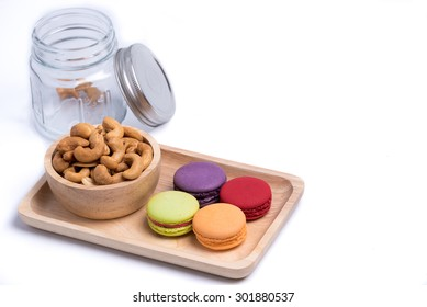 Macaroons and cashew nuts in the woodenware