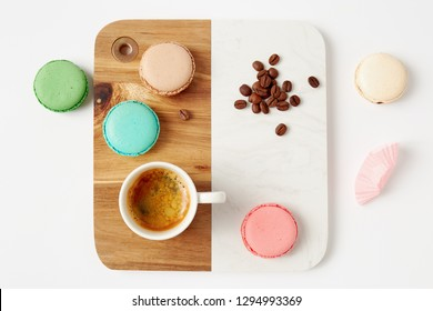 Macaroons and a cup of coffee. Colorful french macaroons with coffee on a white table.