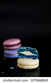 Macaroons on dark background, colorful french cookies macaroons. Macaroons.