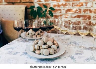 Macaroons on a table with wine