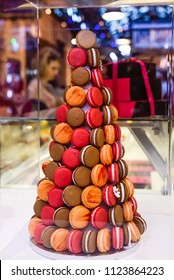 Macaroons tower, pyramid - Assortment of Colorful macarons for sale in candy shop, storefront with sweets, cafe showcase. Traditional french almond cakes pastry. Variety of flavours. Selective focus.