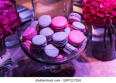 Macaroons in a vase and peonies