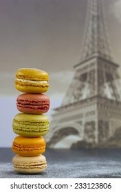 Macaroons/macarons from france with the Eiffel tower at the background.