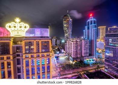 MACAU - APRIL 21, 2014: Lights of City Casinos on a cloudy night. Gambling in Macau has been legal since the 1850s when the Portuguese government legalised the activity in the colony.