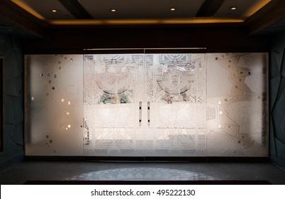 MACAU - AUGUST 08: Babylon glass doors in Babylon casino 08, 2015 at Macau.