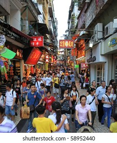 MACAU - AUGUST 1: Tourists are seen visiting the Historic Centre of Macao on August 1, 2010 in Macau, China. The Historic Centre of Macao was inscribed on the UNESCO World Heritage List in 2005.