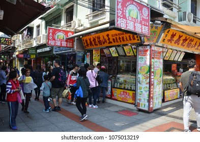 MACAU, CHINA- 07 APR, 2018: People walk on the street of Macau. Macau is also famous with the street food.