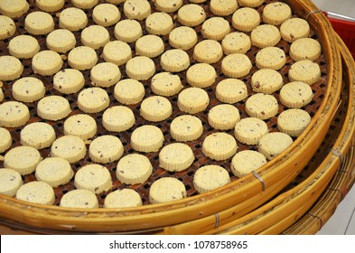 MACAU, CHINA- 07 APR, 2018: Almond cookies from Koi Kei placed on the basket. Koi Kei Bakery is a chain of food souvenir shops based in Macau