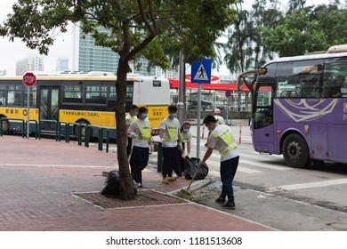 Macau, China 17th September 2018. Off duty police helping with street cleaning