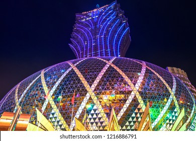 Macau, China - December 8, 2016: tallest tower in Macao and the big dome of Grand Lisboa Casino at night.