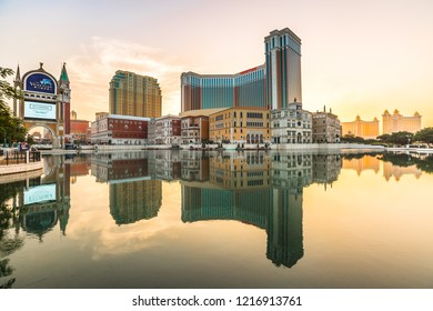 Macau, China - December 9, 2016: Venetian Casino reflecting in the lake at sunset in Cotai Strip. The Venetian Macao casino is similar to the Venetian casino of Las Vegas.