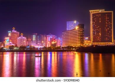 Macau, China - December 9, 2016: Cityscape with Wynn Macau, MGM Macauand Casino Lisboa, popular landmark reflecting in Nam Van Lake, a man-made lake in southern end of Macao Peninsula.