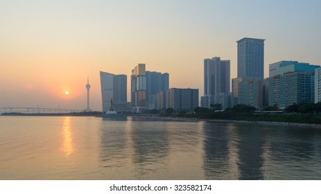 Macau, China - Jan 8, 2013: Skyline of macau city at outer harbour before sunset. The city maintains the world's highest gambling revenue