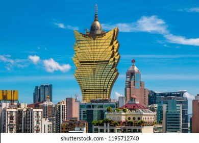 Macau, China - JULY 11, 2014: Great view of the cityscape of Macau including the casino Grand Lisboa with its golden windows, taken on Macau's Mount Fortress Fortaleza do Monte.