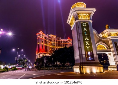 MACAU, CHINA - MARCH 10, 2016: Shining Galaxy Macau Casino Hotel in Cotai Strip, During the Laser Show, Macao Typical Street Scene of Nightlife