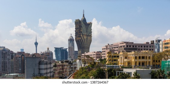 Macau, China - March 13th 2018 - Portuguese colony until 1999, a Unesco World Heritage site, Macau presents a wonderful skyline. Here in particular it's more notable building, the Grand Lisboa Hotel