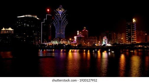MACAU, CHINA - May 11, 2018: Macau Bay  The calm waters of Macau Bay Illuminated by the large casino buildings
