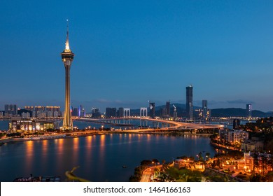 Macau, China - May 31, 2018: Evening Skyline of Macao Praia Grande, Sai Van Bridge, Taipa District and Tower, Torre de Macau.