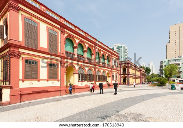 MACAU, CHINA - NOVEMBER 1, 2012: Old buildings from the time period of the Portuguese on the Tap Seac Square. Macau annually visited by about 29 million tourists from different countries.