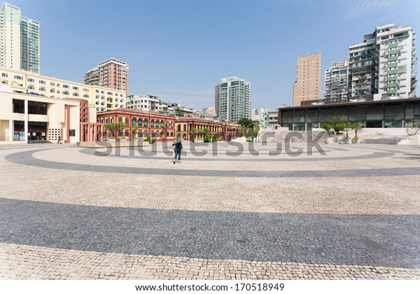 MACAU, CHINA - NOVEMBER 1, 2012: Tap Seac Square lined by the famous Portuguese wavy stone pavers and is surrounded by old buildings. Macau annually visited by about 29 million tourists.