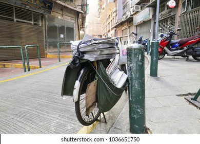 MACAU, CHINA - OCT 22 : Old bicycle with of newspapers urban street in macau on Oct 22 2017